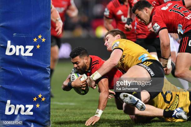 Richie Mo'unga of the Crusaders dives over to score a try during the Super Rugby Semi Final match between the Crusaders and the Hurricanes at AMI...