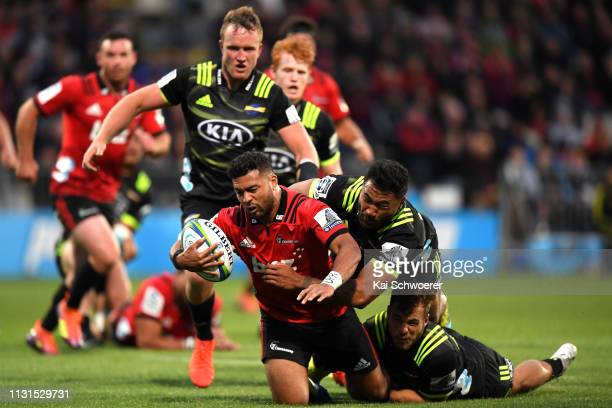 Richie Mo'unga of the Crusaders dives over to score a try during the round two Super Rugby match between the Crusaders and the Hurricanes at...