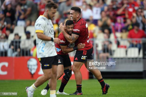 Richie Mo'unga of the Crusaders is congratulated by Codie Taylor of the Crusaders after scoring a try during the round two Super Rugby Aotearoa match...