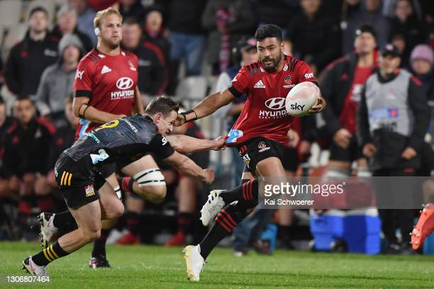 Richie Mo'unga of the Crusaders is tackled by Brad Weber of the Chiefs during the round three Super Rugby Aotearoa match between the Crusaders and...