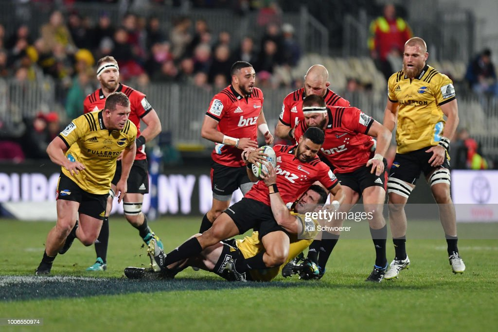 Richie Mo'unga of the Crusaders is tackled by Nehe Milner-Skudder of the Hurricanes during the Super Rugby Semi Final match between the Crusaders and the Hurricanes at AMI Stadium on July 28, 2018 in Christchurch, New Zealand.