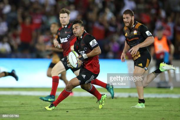 Richie Mo'unga of the Crusaders makes a break during the round 13 Super Rugby match between the Chiefs and the Crusaders at ANZ Stadium on May 19...