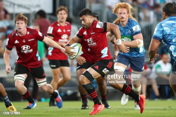 Richie Mo'unga of the Crusaders makes a break during the round 3 Super Rugby match between the Blues and the Crusaders at Eden Park on February 14...