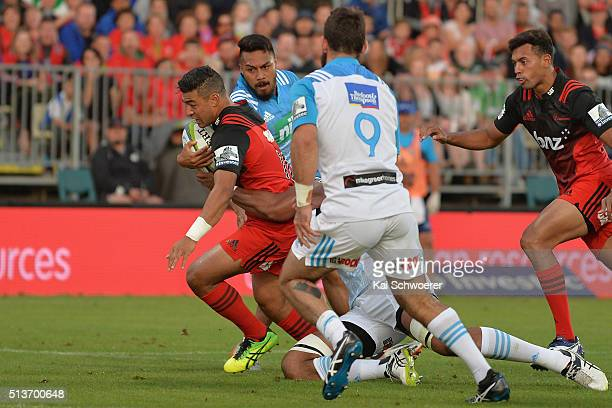Richie Mounga of the Crusaders makes a break during the round two Super Rugby match between the Crusaders and the Blues at AMI Stadium on March 4...