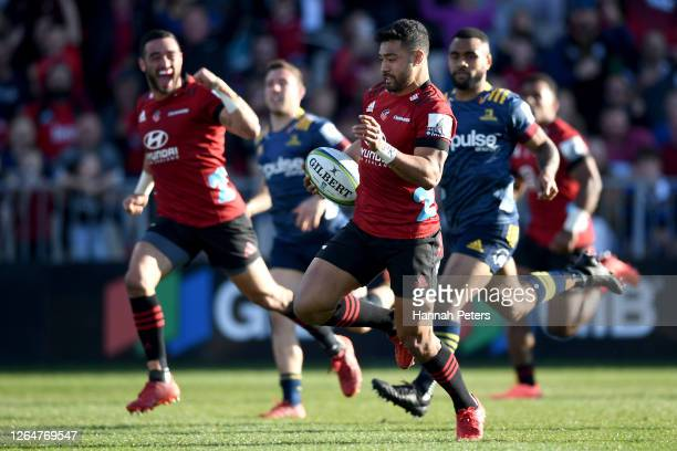 Richie Mo'unga of the Crusaders runs in to score a try during the round 9 Super Rugby Aotearoa match between the Crusaders and the Highlanders at...