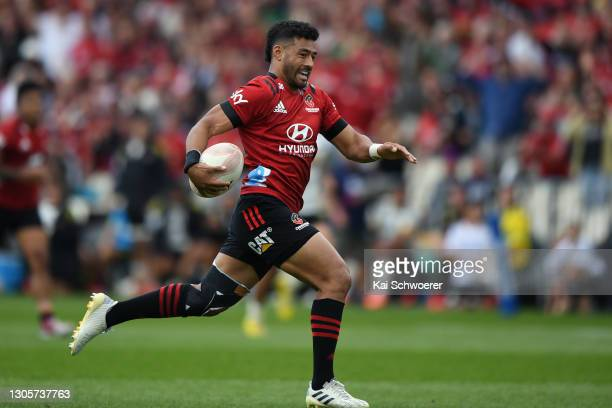 Richie Mo'unga of the Crusaders runs through to score a try during the round two Super Rugby Aotearoa match between the Crusaders and the Hurricanes...