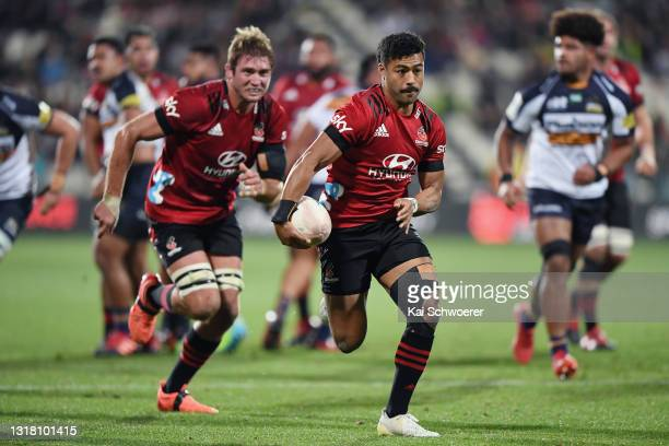 Richie Mo'unga of the Crusaders runs through to score a try during the round one Super Rugby Trans-Tasman match between the Crusaders and the ACT...