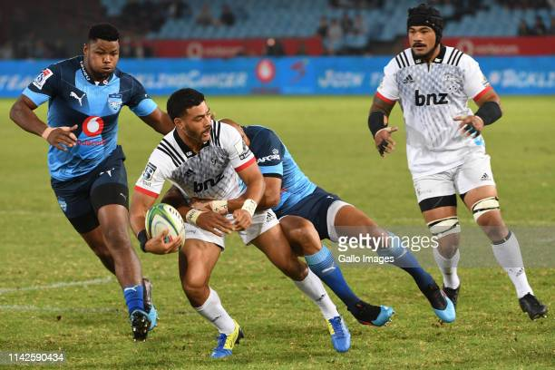 Richie Mounga of the Crusaders tackled by Cornal Hendricks of the Bulls during the Super Rugby match between Vodacom Bulls and Crusaders at Loftus...