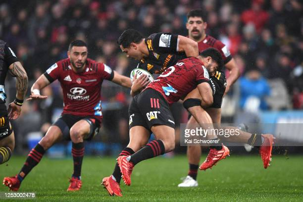 Richie Mo'unga of the Crusaders tackles Anton Lienert-Brown of the Chiefs during the round 3 Super Rugby Aotearoa match between the Crusaders and the...