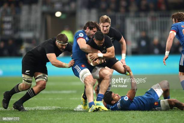 Richie Mo'unga of the New Zealand All Blacks is tackled during the International Test match between the New Zealand All Blacks and France at Forsyth...