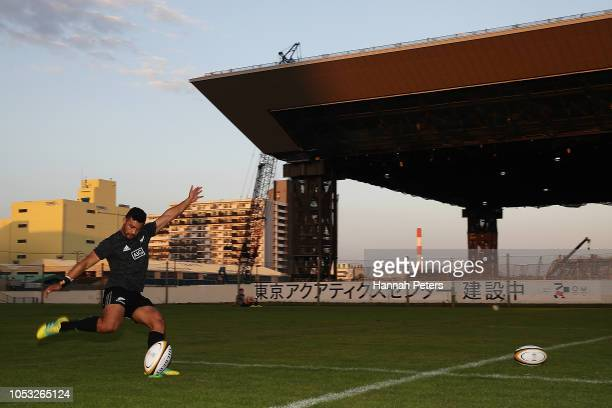 Richie Mo'unga practices his kicking during a New Zealand All Blacks training session on October 25 2018 in Tokyo Japan