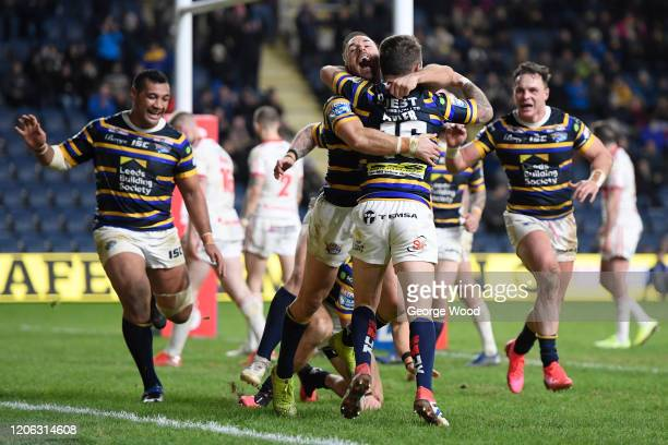 Richie Myler of Leeds Rhinos celebrates with team mates after scoring his sides ninth try during the Betfred Super League match between Leeds Rhinos...