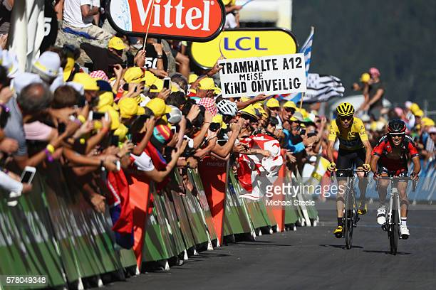 Richie Porte of Australia and BMC Racing Team ahead of yellow jersey race leader Chris Froome of Great Britain and Team Sky at the finish line during...