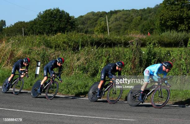 Richie Porte of Australia and Ethan Hayter of United Kingdom and Team INEOS Grenadiers turquoise points jersey lead their teammates during the 17th...