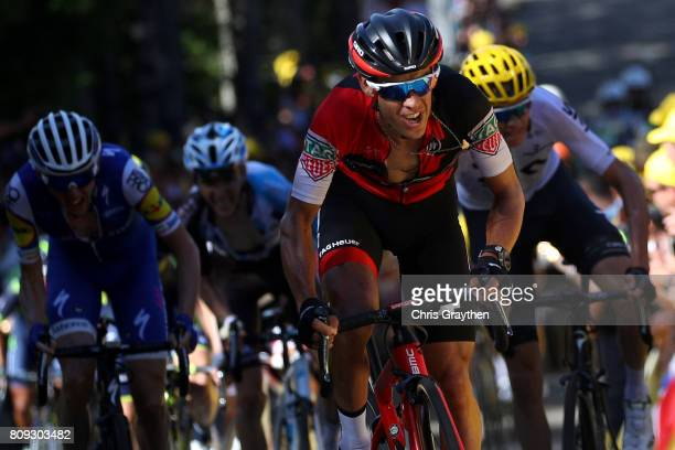 Richie Porte of Australia riding for BMC Racing Team leads Daniel Martin of Ireland riding for QuickStep Floors and Christopher Froome of Great...