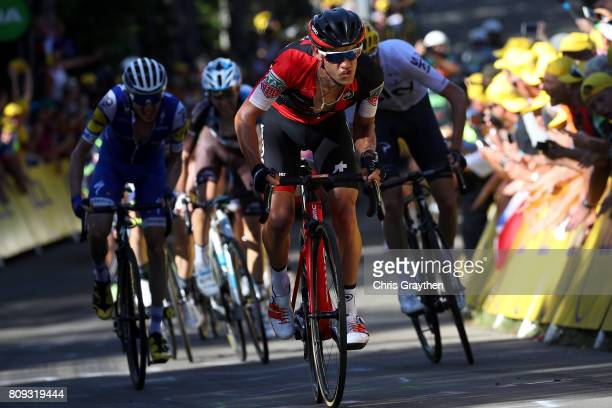 Richie Porte of Australia riding for BMC Racing Team leads Daniel Martin of Ireland riding for Quick-Step Floors and Christopher Froome of Great...