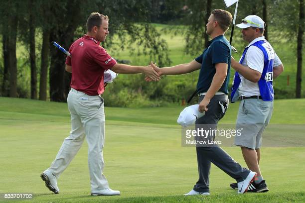 Richie Ramsay of Scotland congratulates Tom Lewis of England on his victory on the 16th green during round one of the Saltire Energy Paul Lawrie...