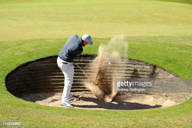 Richie Ramsay of Scotland hits his third shot on the 2nd hole during day four of the Betfred British Masters at Hillside Golf Club on May 12, 2019 in...