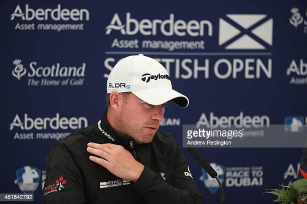 Richie Ramsay of Scotland holds his injured shoulder during a press conference at the Aberdeen Asset Management Scottish Open at Royal Aberdeen on...