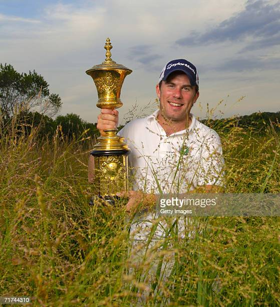 Richie Ramsay of Scotland holds up the trophy after winning the 2006 US Amateur at Hazeltine National Golf Club on August 27 2006 in Chaska Minnesota...