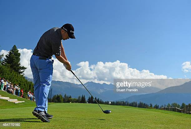Richie Ramsay of Scotland plays a shot during the third round of the Omega European Masters at CranssurSierre Golf Club on September 6 2014 in...