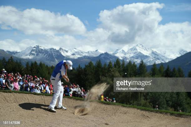 Richie Ramsay of Scotland plays from a fairway bunker on the 12th during final round of the Omega European Masters at CranssurSierre Golf Club on...