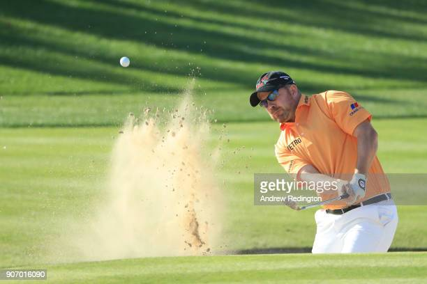 Richie Ramsay of Scotland plays his third shot from a bunker on the second hole during round two of the Abu Dhabi HSBC Golf Championship at Abu Dhabi...