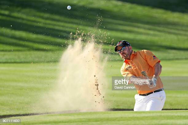 Richie Ramsay of Scotland plays his third shot on the par 5 second hole during the second round of the 2018 Abu Dhabi HSBC Golf Championship at the...