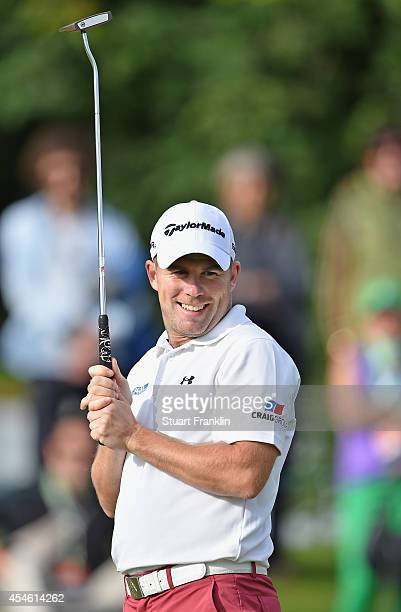 Richie Ramsay of Scotland reacst to a putt during the first round of the Omega European Masters at CranssurSierre Golf Club on September 4 2014 in...