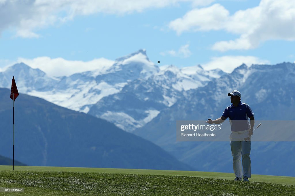 Richie Ramsay of Scotland tosses his ball to his caddy on the 7th green during the final round of the Omega European Masters at Crans-sur-Sierre Golf Club on September 2, 2012 in Crans, Switzerland.