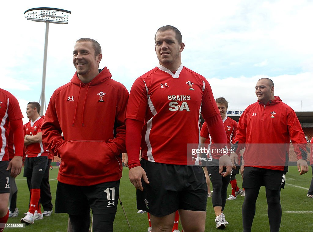 Richie Rees (L) and Paul James (C) of Wales leave the ground following the Wales Captain's Run at Waikato Stadium on June 25, 2010 in Hamilton, New Zealand.