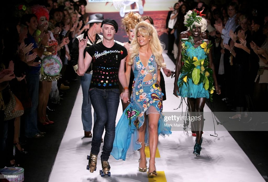 Richie Rich and Paris Hilton walk the runway at the Marchesa Spring 2007 fashion show during Olympus Fashion Week at the Daryl Roth Theater September 12, 2006 in New York City.