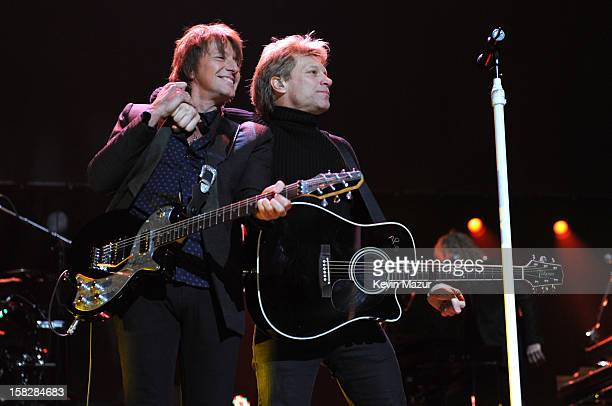 Richie Sambora and Jon Bon Jovi perform at '121212' a concert benefiting The Robin Hood Relief Fund to aid the victims of Hurricane Sandy presented...