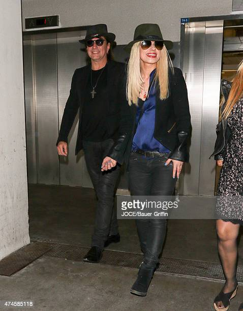 Richie Sambora and Orianthi are seen arriving into LAX on May 23 2015 in Los Angeles California