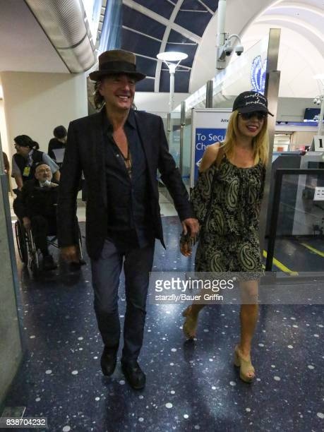 Richie Sambora and Orianthi Panagaris are seen at Los Angeles International Airport on August 24 2017 in Los Angeles California