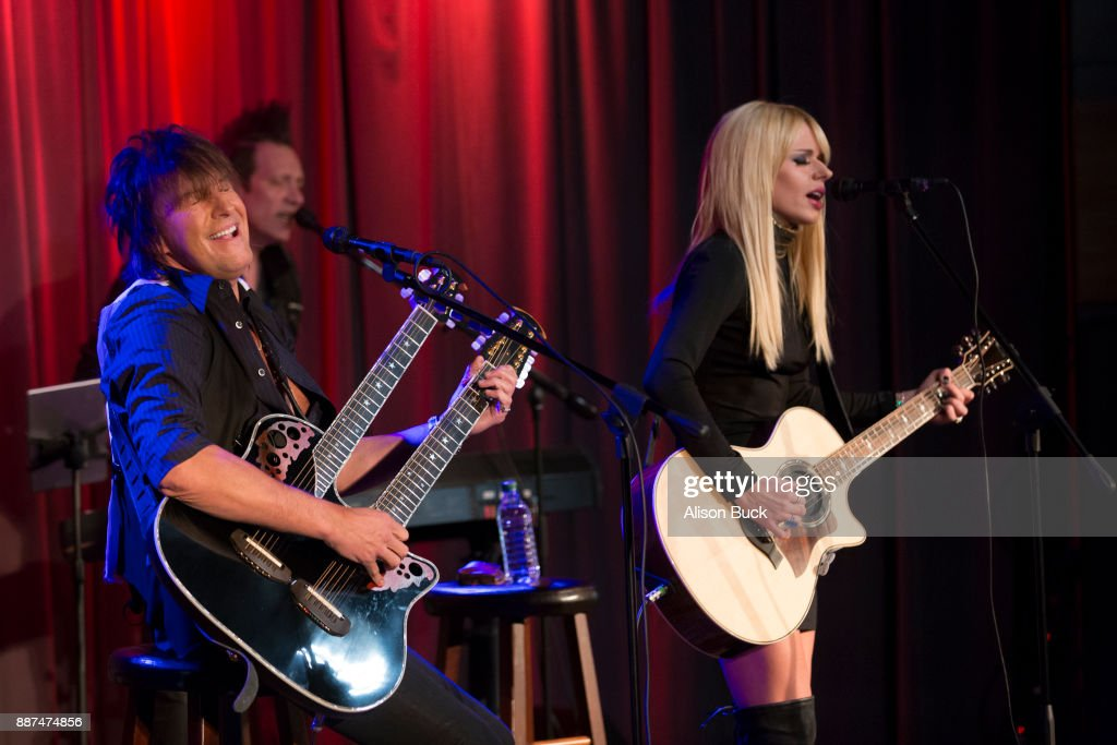 Richie Sambora and Orianthi perform onstage during The Drop: