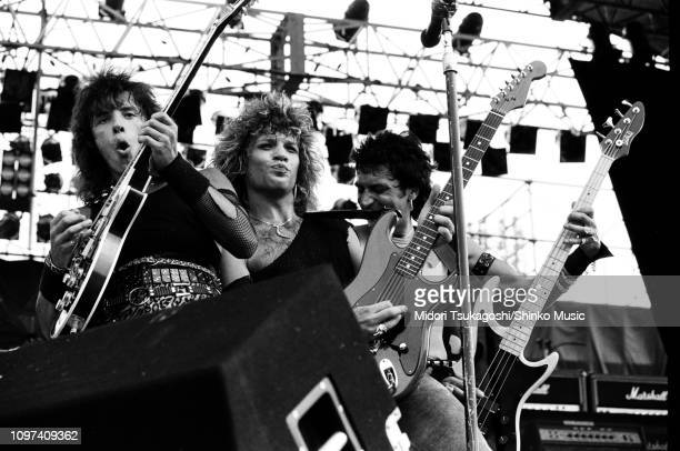 Richie Sambora Jon Bon Jovi and Alec John Such of Bon Jovi perform on stage at Nagoya Stadium for Super Rock '84 4th August 1984 Tokyo Japan