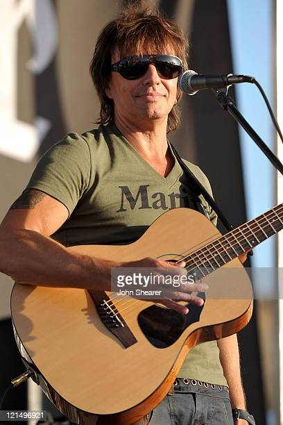 Richie Sambora performs after donateing guitars to US Marines at Camp Pendleton on August 19 2011 in Oceanside California