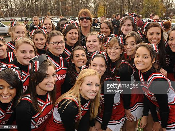 Richie Sambora with the Woodbridge High School Barrons Cheerleaders at the unveiling of the Richie Sambora street re-naming on November 24, 2009 in...