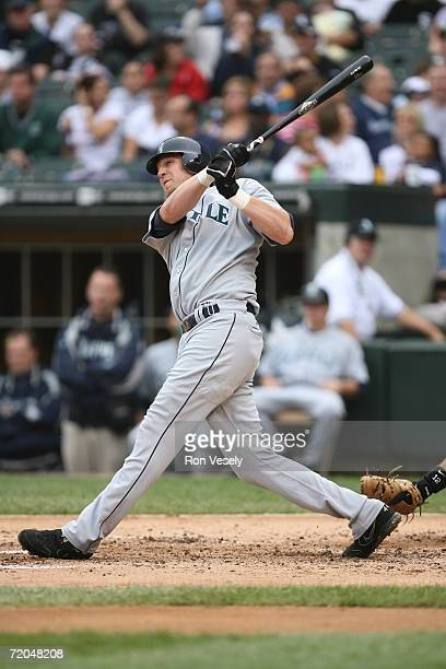 Richie Sexson of the Seattle Mariners hits this 32nd home run of the season off of Mark Buehrle during the game against the Chicago White Sox at U.S....