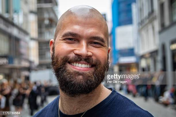 Richie Talboy smiles at the opening of the Richie Talboy and Yael Quint Exhibition at the Fushion Fashion Art Festival on August 28 2019 in Oslo...