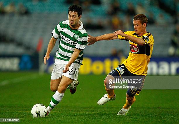 Richie Towell of Celtic controls the ball ahead of Oliver Bozanic of the Mariners during the international friendly club match between the Central...