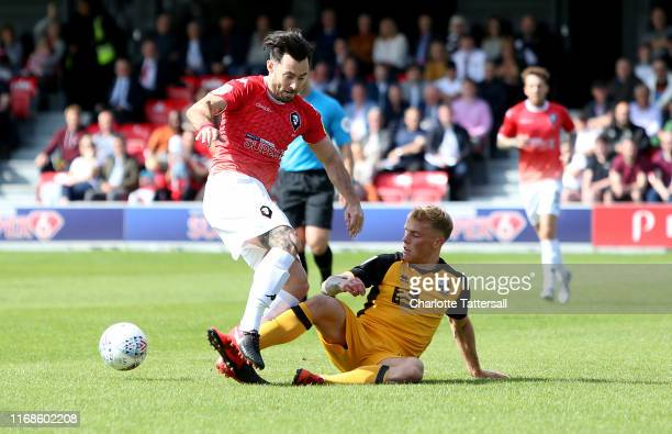 Richie Towell of Salford City is tackled by Tom Conlon of Port Vale compete for the ball during the Sky Bet League Two match between Salford City and...