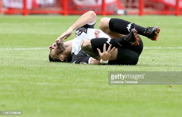 Richie Towell of Salford City lies on the floor injured during the Sky Bet League Two match between Crawley Town and Salford City at The Peoples...