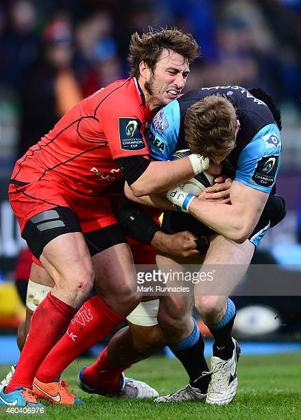 Richie Vernon of Glasgow Warriors is tackled by Maxime Medard of Toulouse during the European Rugby Champions Cup Pool 4 match between Glasgow...
