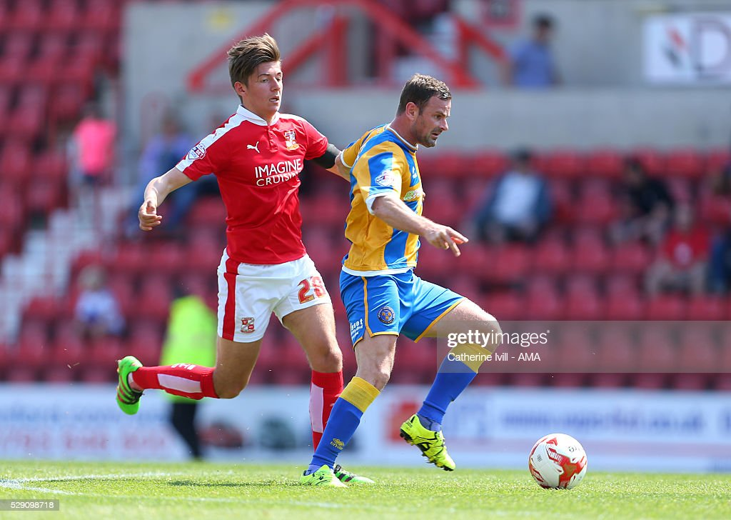 Richie Wellens of Shrewsbury Town and Ellis Iandolo of Swindon Town during the Sky Bet League One match between Swindon Town and Shrewsbury Town at County Ground on May 8, 2016 in Swindon, England.