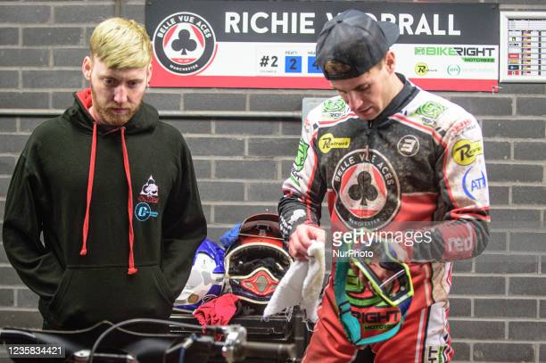 Richie Worrall cleans his helmet as he chats with Belle Vue Colts rider Paul Bowen during the SGB Premiership Grand Final 1st Leg between Belle Vue...