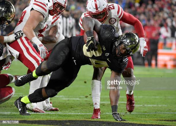 Richie Worship of the Purdue Boilermakers runs for a touchdown during the second quarter of the game between the Purdue Boilermakers and the Nebraska...
