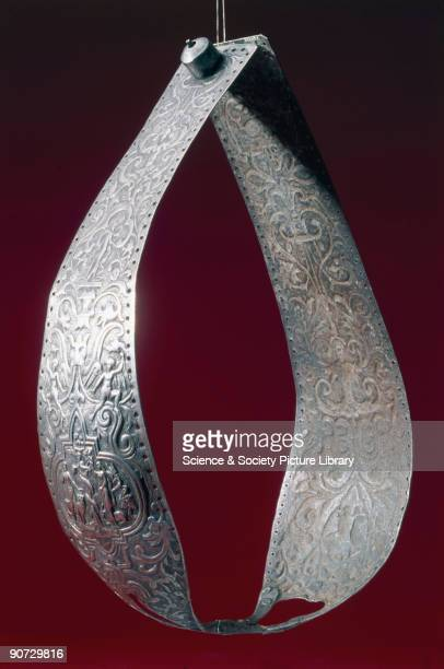 Richly decorated metal chastity belt consisting of two panels hinged together Chastity belts originated in the 15th century They were devices...