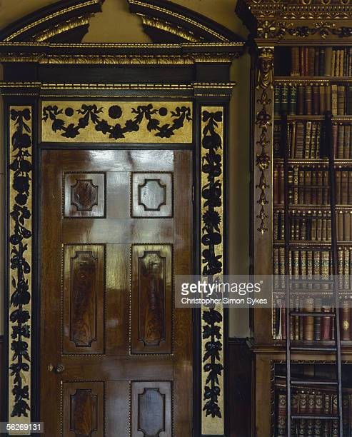 Richly ornamented doorway in the library of Highclere Castle, Berkshire, 1980s.